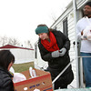 12-25-13<br /> Kokomo Urban Outreach Annual Christmas Blitz<br /> Stacey and Abby Tice deliver lunches provided by Kokomo Urban Outreach's Annual Christmas Blitz to Anthony Jones in Riley Modern Estates on Christmas Day. <br /> KT photo | Kelly Lafferty