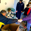 12-20-13   ---  The Rescue Missions Red Ribbon Christmas food and gift delivery. Hundreds of volunteers loaded and delivered trucks and vans full of gift boxes. Kevin Bostic, Barbara Glosser, Angie Bostic, Conner Bostic, Kendall Bostic and Klair Merrell pray after the Bostic family delivered a food and gift box to Glosser.<br />   KT photo | Tim Bath