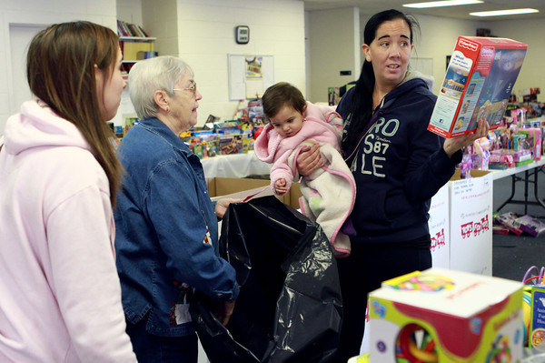 12-19-13<br /> Toys for Tots<br /> Jennifer Shields (right) shops with her daughter Alicia (left), with the help of Nancy Bessler, for Gabriella Shields, Jennifer's granddaughter.<br /> KT photo | Kelly Lafferty