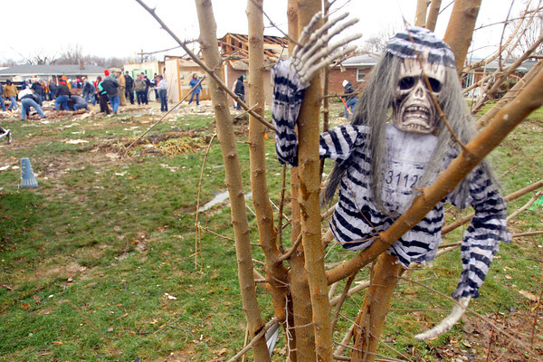 11-22-13  KT photo   Tim Bath   ---  As cleanup goes on around a decoration from Halloween sits in a backyard tree in the path of the tornado.<br /> Camera: Canon EOS-1D Mark III - Shutter Speed: 1/200 - Aperture f2.8 - ISO:200 - Color Balance: Cloudy - Lense: Canon 16-35mm @ 16mm