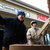 12-12-13<br /> David Weideman (left) and David Brownfield help move boxes into Mid-Central Trophy on Thursday.<br /> KT photo | Kelly Lafferty