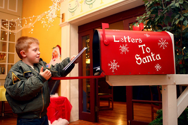12-7-13<br /> Santa Downtown Kokomo<br /> Weston Graves, 6, puts his letter in Santa's mailbox located in Planet Mind after he wrote him asking for an Easy Bake Oven on Saturday.<br /> KT photo | Kelly Lafferty