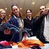 12-17-13<br /> Caring and Sharing for the Holidays<br /> Kassandra Rickerd, Patricia Adams, Josh Long, and Dana Shanabarger look through the clothes during Caring and Sharing for the Holidays, put on by Tiffany Burns.<br /> KT photo | Kelly Lafferty