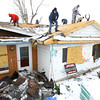 12-16-13   ---  A crew from BeeBee Home Inprovement tear off the old damaged roof to replace it at 1608 Meadowbrook Drive after the tornado heavily damaged the house. Workers are Joe Langley, Cody Cyr, Robert Bono,k Aaron Waldman and Jeremy Goshert.<br />   KT photo | Tim Bath