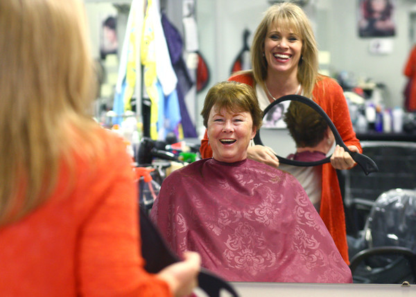 "12-5-13<br /> Communities in Denver, Indiana<br /> Holly Donaldson and her hairdresser, Kim Fortney, laugh together as Fortney shows Donaldson the back of her hair after her haircut at ""A Li'l off the Top"" Style Shop in Denver, Ind.<br /> KT photo 