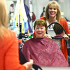 """12-5-13<br /> Communities in Denver, Indiana<br /> Holly Donaldson and her hairdresser, Kim Fortney, laugh together as Fortney shows Donaldson the back of her hair after her haircut at """"A Li'l off the Top"""" Style Shop in Denver, Ind.<br /> KT photo 