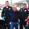 12-3-13<br /> A suspect is led by police to the ambulance from Cirilla's.<br /> <br /> KT photo | Kelly Lafferty