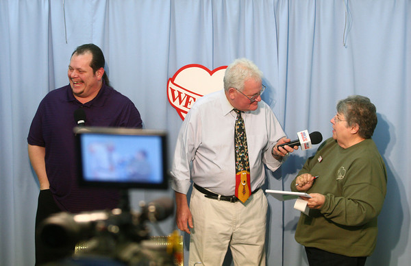 12-8-13<br /> We Care Sunday<br /> JR Dennis and Bill Tandy collect the final numbers of money raised for We Care on Sunday.<br /> KT photo | Kelly Lafferty