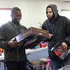 12-19-13<br /> Toys for Tots<br /> Cpl. Fred Berry holds up a toy for Armaine Stafford to look at during Toys for Tots on Thursday.<br /> KT photo | Kelly Lafferty
