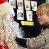 12-18-13<br /> Western's Christmas Party <br /> Gavin Tragesser of Tipton touches Santa's beard as he visited Western Primary on Wednesday.<br /> KT photo | Kelly Lafferty