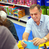 12-17-13   ---  Goodfellows shopping at Meijer on Tuesday evening. Volunteer Billy Gaunt working with Goodfellows recipients at one of the shopping nights at Meijer.<br />   KT photo | Tim Bath