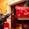 12-7-13<br /> Santa Downtown Kokomo<br /> Weston Graves, 6, puts his letter in Santa's mailbox located in Planet Mind after he wrote him asking for an Easy Bake Oven on Saturday.<br /> KT photo   Kelly Lafferty