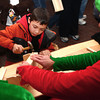 12-7-13<br /> Santa Downtown Kokomo<br /> Ashton Sexton hammers a nail on a project in Santa's workshop on Saturday.<br /> KT photo | Kelly Lafferty
