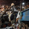 12-26-13<br /> Kokomo Recycling Center<br /> The Bobcat is operated to put recycled materials into the baler at the Kokomo Recycling Center.<br /> KT photo | Kelly Lafferty