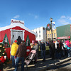 12-7-13<br /> Santa Downtown Kokomo<br /> The line winds around the courthouse to visit Santa and Mrs. Claus in their house in front of Kokomo's courthouse.<br /> KT photo | Kelly Lafferty