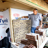 12-9-13   ---  Dennis and Evan Macy  with Macy and Sons Masondry lay bricks on the front of a house being built by VanNatter Construction in the Fredrick Farms subdivision.<br />   KT photo | Tim Bath