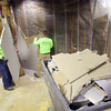 12-24-13   ---  Carpenters Union Local 274 workers Steve Sutton and Brock Corcoran working for Hayes Brothers Contruction take down drywall and insulation so a wall can be rebuilt at the UAW training facility that was damaged by the November tornado.<br />   KT photo | Tim Bath