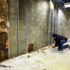 12-24-13   ---  IBEW Electrician Jim Closson working for Huston Electric documents and removes wiring so a wall can be rebuilt at the UAW training facility that was damaged by the November tornado.<br />   KT photo | Tim Bath