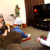 12-23-13   ---  Brian, Bridget and Zak College who's home was heavily damaged by the tornado will be spending Christmas in a small apartment. Zak and Bridget play with the dogs in the small living room of the apartment with not enough room for a full size Christmas tree.<br />   KT photo | Tim Bath