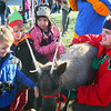 12-7-13<br /> Santa Downtown Kokomo<br /> Ian, Collin, and Brooke Wilson pet a reindeer that one of Santa's elves brought to Kokomo on Saturday afternoon.<br /> KT photo   Kelly Lafferty