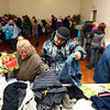 12-17-13<br /> Caring and Sharing for the Holidays<br /> People line the perimeter of the room at Celebrations as they look through donated items during Caring and Sharing for the Holidays, put on by Tiffany Burns.<br /> KT photo | Kelly Lafferty