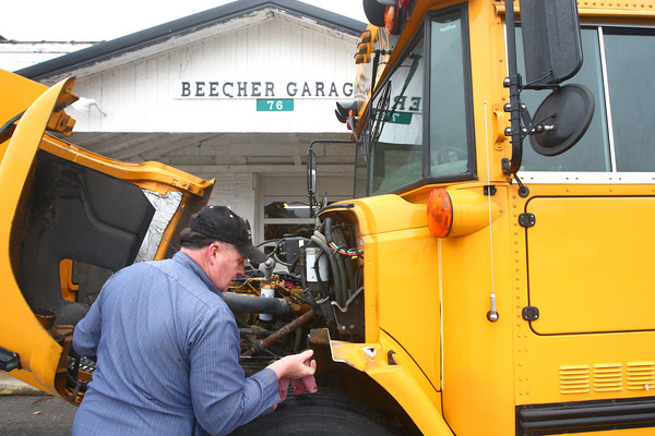 12-5-13<br /> Communities in Denver, Indiana<br /> Rich Robins works on a school bus in front of Beechers Garage in Denver, Ind.<br /> KT photo | Kelly Lafferty