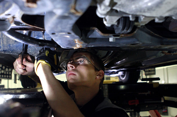 12-12-13<br /> Ivy Tech auto institute<br /> Zachary Thomas works underneath a car on an alignment at the Ivy Tech auto institute.<br /> KT photo | Kelly Lafferty