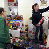 12-19-13<br /> Toys for Tots<br /> Sgt. Jessica Stewart holds up toys for Falisha Shutt to choose from during Toys for Tots on Thursday.<br /> KT photo | Kelly Lafferty