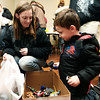 12-17-13<br /> Caring and Sharing for the Holidays<br /> Andrea Franks smiles as Wyatt Johnson picks out dinosaur toys during Tiffany Burns' Caring and Sharing for the Holidays.<br /> KT photo | Kelly Lafferty