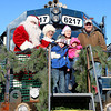 12-7-13<br /> Santa Downtown Kokomo<br /> Members of the Beining family, including Ryan, center, were special guests on Santa's train on Saturday afternoon.<br /> KT photo | Kelly Lafferty