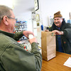 12-5-13<br /> Communities in Denver, Indiana<br /> Glenn Stevens (right) of The Denver Hardware store laughs with Eddie Hannah as he checks him out at the register.<br /> KT photo | Kelly Lafferty