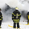 12-14-13<br /> Firefighters work to extinguish an engulfed garage on N. Apperson on Saturday.<br /> KT photo | Kelly Lafferty
