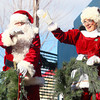 12-7-13<br /> Santa Downtown Kokomo<br /> Santa and Mrs. Claus wave as the train rolls into downtown Kokomo on Saturday afternoon.<br /> KT photo   Kelly Lafferty