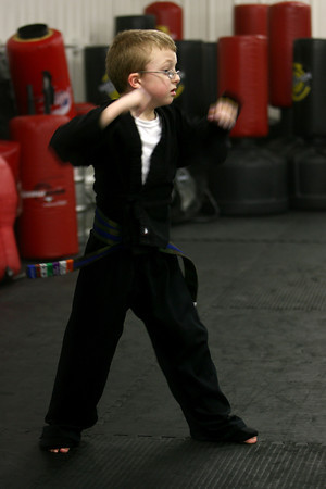 1-28-13<br /> Kids from 3-6 years old doing martial arts at Indiana Pit.<br /> Ty Frazier, 6, protecting his face as he moves.<br /> KT photo | Tim Bath