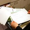 2-11-13<br /> Kokomo Howard County Public Library genealogy department. Marcia Ford looks through documents on Rush Cemetery.<br /> KT photo | Tim Bath