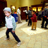 2-8-13<br /> Night to Remember mother/son event at Casa Bella<br /> Bryan Futerfas, 3, dancing with a group of boys and parents.<br /> KT photo | Tim Bath
