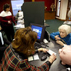 2/3/03<br /> CommunityFirst bank manager Tina Granson checks out paperwork from Bernice Ferenc, 89, and receiving additional help from President and CEO Mike Stegall. She is the oldest shareholder and is opening the first account<br /> Kt photo by Tim Bath