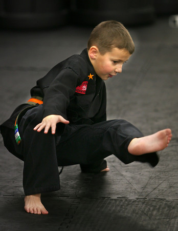 1-28-13<br /> Kids from 3-6 years old doing martial arts at Indiana Pit.<br /> Cameron Davis, 6, practicing protection as he gets up.<br /> KT photo   Tim Bath