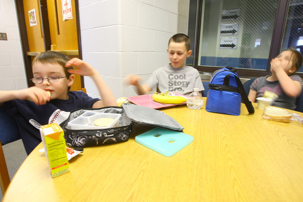 2-12-14   --- Clinton Hunter, 7, who is highly allergic to peanut butter, has to eat in the school office away from any possible contact. He does get to bring friends Grayson Jackson, 8, and Abby Bentley, 7, with him so he does not have to eat alone. -- <br />   KT photo | Tim Bath