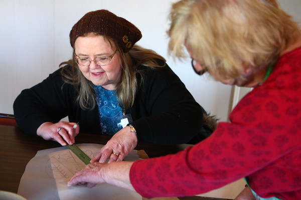 2-22-14<br /> Winter Woolen Workshop<br /> Debby Beheler learns the art of decorative painting from Carol Bowlin of The Paint Box during a class at the 8th Annual Winter Woolen Workshop.<br /> KT photo | Kelly Lafferty