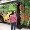 1-31-14<br /> Howard the bear points out his picture on the Howard County Public Library's bookmobile, as people wait to look inside. Ivy Tech will fund $20,000 to sponsor Howard County Library's new bookmobile for the next three years.<br /> KT photo | Kelly Lafferty