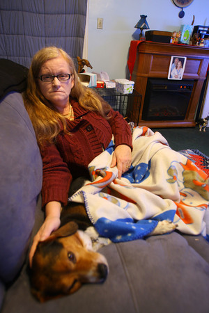 1-31-14   ---  Darla White sits in her living room with an electric heater in the back and a blanket over her. She ran out of propane and had to borrow money to pay for more due to the high cost because of the propane shortage. -- <br />   KT photo | Tim Bath