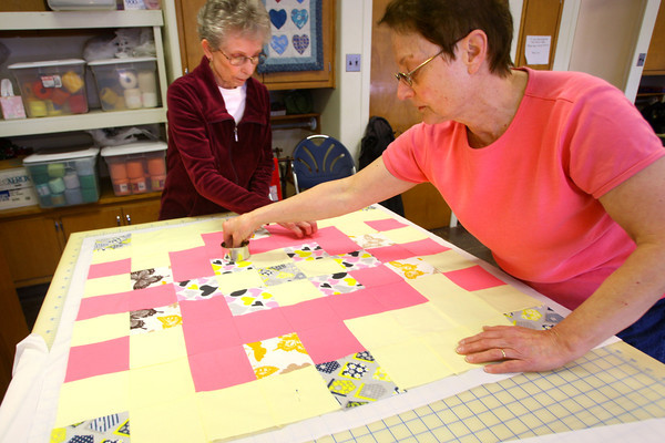 2-13-14   --- Good Samaritan Circle is a group of women at Main Street UMC that meet to sew for charity. Sarah Lear and June Smith working on a quilt. -- <br />   KT photo | Tim Bath