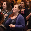 2-27-14<br /> Author John David Anderson visits Northwestern<br /> Eighth graders Maci Weeks (right) and Megan Osman laugh as they take an audience pledge during author John David Anderson's presentation at Northwestern.<br /> KT photo | Kelly Lafferty