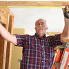 2-27-14<br /> Designer Show Home<br /> Les Hardin of Hardin Construction measures a structural beam in between the kitchen and dining room of the Designer Show Home.<br /> KT photo | Kelly Lafferty