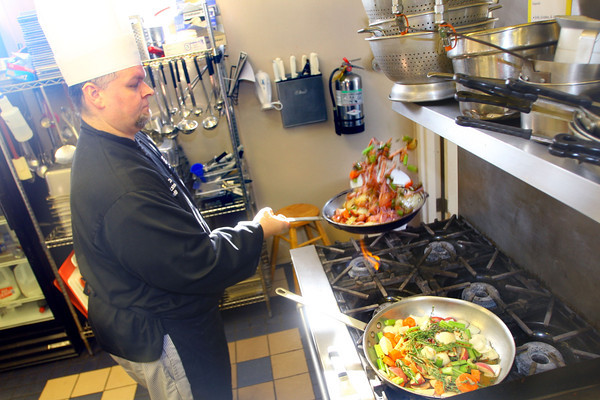 2-6-14   ---  Rescue Mission Chef Anthony Brunnermer working in the kitchen at the mission preparing lunch and dinner. -- <br />   KT photo | Tim Bath