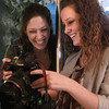 2-21-14<br /> Harmon photography in Peru<br /> Bridgette Harmon-Smith, right, shows Heather Sites photos she took of Sites' son at Harmon Photography.<br /> KT photo | Kelly Lafferty