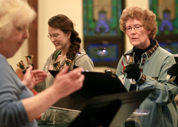 2-19-14<br /> Hand bell practice at Shiloh United Methodist Church<br /> Mary Ellen Harnish (right) and Susan Hall (left) play a song during hand bell practice at Shiloh United Methodist Church.<br /> KT photo | Kelly Lafferty