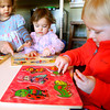 2-5-14   ---  Caterpillar Clubhouse Daycare on North Armstrong owned and operated by Stephanie McKinstry. Piper Schuck, Emma McKinstry and Ellerey Bridges work on puzzles. -- <br />   KT photo | Tim Bath