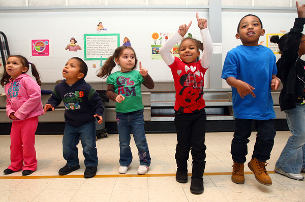 2-24-14<br /> Darrough Chapel Head Start<br /> From left: Victoria Bradley, Alberto Martin, Josaline Lopez, Janay Olivares, and Kyzier Clark dance in the cafeteria during GAMO at Darrough Chapel.<br /> KT photo | Kelly Lafferty